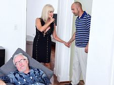 64-year-old Leah screws. Her husband watches.