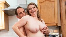 Busty mom fucks in the kitchen